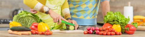 benefits of weight loss surgery - couple cutting vegetables for a healthy meal