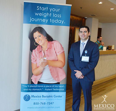 Mexico Bariatric Center. Los Angeles bariatric surgery seminar 2016. Dr. Alejandro Gutierrez outside the conference room next to the MBC greeting sign.