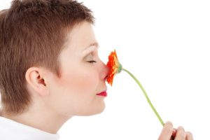 grounding exercises, woman smelling a flower