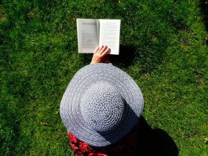 top gastric sleeve books, woman in a hat reading a book