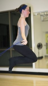 home exercise program, woman with jump roap