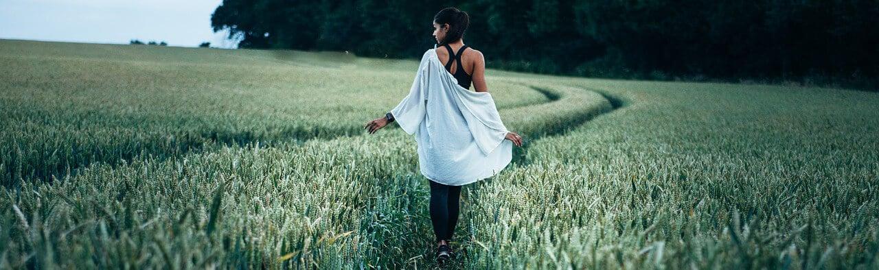 self image, woman walking in field