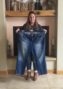 gastric sleeve surgery in Tijuana, crystal holding her old pants to show her weight loss success