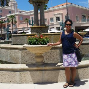 Esther, a gastric sleeve success story with Mexico Bariatric Center standing outside by a fountain.
