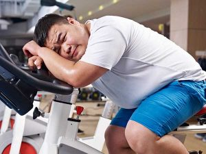 Quick weight loss. Exhausted man on a treadmill.