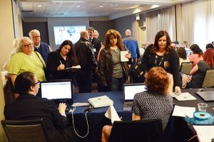 Guests at the sign-in desk for the seminar.