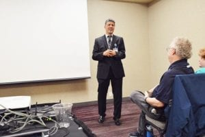 CEO Ron Elli speaking to the seminar guests