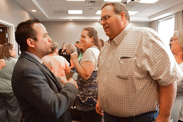Dr. Cabrera speaking to a guest after the seminar