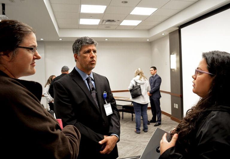 Ron Elli, Ph.D. speaking with guests after the seminar ended - Mexico Bariatric Center - Portland, OR Bariatric Surgery Seminar